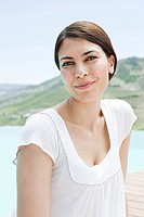 Mid adult woman on holiday looking at camera