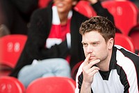 Supporter watching football match (thumbnail)