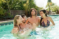 Young friends in swimming pool on vacation (thumbnail)