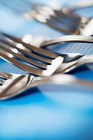 Silverware. Forks detail with selective focus