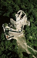 aerial views of Hungary´s cultural heritage: The ruins of Hollókö castle 13th c near the village of Hollókö - a World Heritage site