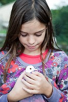 young girl holding her dove
