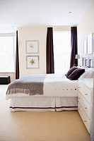 A bedroom decorated in restful tones of grey, white, brown and cream
