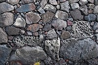 Close_up of lava rock wall.