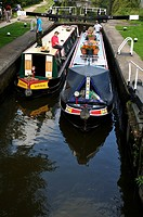 Two narrow boats in Apsley Lock 65 on the Grand Union Canal, Hertfordshire, UK