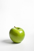 One single green Granny Smith apple