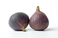 Two fresh figs on plain background