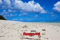 reserved sign and GUAM beach.