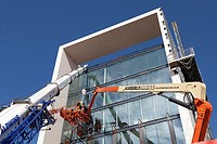construction workers working at height to install cladding on Southern Operational Command Unit Southampton