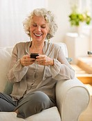 Cheerful woman texting