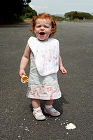 Little girl with her ice cream that has dropped on the floor