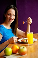 Young lady eating healthy food