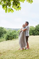 Mature couple embrace in park