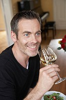 Man sipping on white wine
