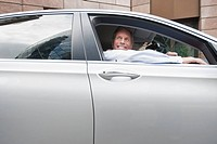 Smiling Businessman Sat in Car