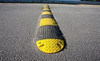 yellow striped speed bump