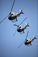 Three Eurocopter Colibri helicopters belonging to the ASPA aerobatic team. Spanish Air Force in an aereal exhibition in Málaga, Andalusia, Spain