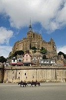Riding horses in Mont Saint-Michel, la Manche, Basse Normandie, France