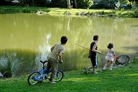 Children hunting frogs, Grenoble, Rhône-Alpes, France