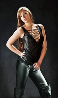 Girl in provocative pose wearing exotic leather outfit