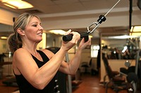 Woman exercising on gym equipment