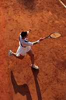 Female Tennis player returns a service on a clay court tennis court