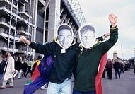 Rugby fans wearing masks outside stadium