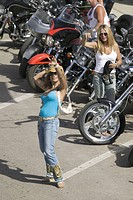 Sexy girls posing with bikes on Main Street at the 67th Annual Sturgis Motorcycle Rally, Sturgis, South Dakota, August 6_12, 2007