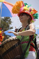 Woman drummer at annual Summer Solstice Celebration and Parade June 2007, since 1974, Santa Barbara, California