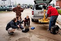 Vortex 2 scientists prepare a tornado pod, a probe designed to measure the windfield inside a tornado, in Perry, Oklahoma, May 10, 2010  Storm Chaser ...