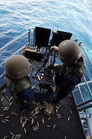PACIFIC OCEAN Sept  14, 2010 Gunner's Mate 1st Class Nona Butler, left, and Gunner's Mate 3rd Class Andrew Just reload a 50-caliber machine gun during...