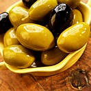 Black and Green Olives in Olive Oil in a Small Bowl