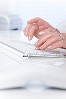 Woman's hand typing on a keyboard