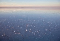 Sunrise on the world´s largest salt flats, with a thin water layer