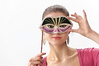 Cute teenage girl with a Venitian carnival mask on white background