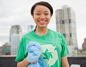 Smiling mixed race teenage girl wearing recycling t-shirt (thumbnail)