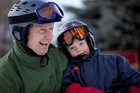 red deer, alberta, canada, a father and young son wearing helmets and ski masks