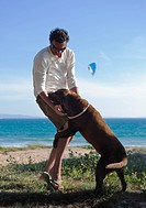 tarifa, cadiz, andalusia, spain, a man and his dog at arte y vida beach in costa de la luz