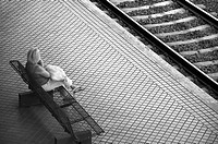 Woman waiting for a train, Northern Station, Donostia-San Sebastián, Guipúzcoa, Basque Country, Spain