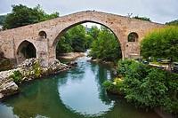 Roman Bridge. Cangas de Onis. Oriente region. Picos de Europa. Asturias. Spain.