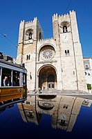 SE CATHEDRAL WITH REFLECTION AND TRAMWAY, ALFAMA DISTRICT, LISBON
