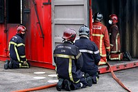 TRAINING FIREFIGHTERS WITH A FIRE CONTAINER IN PARTNERSHIP WITH THE FIRE AND RESCUE SERVICES, NATIONAL CENTER OF PREVENTION AND PROTECTION CNPP IN VER...