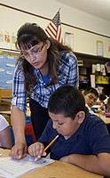 Detroit, Michigan - A Hispanic teacher works with students in a mostly-Hispanic classroom at Harms Elementary school  Teachers and para-professionals ...