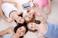 Four young women lying in circle taking self_portrait