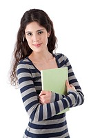 Young woman holding a book, smiling