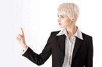 Young businesswoman about to touch with one finger