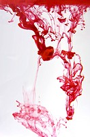 Paint of red dissolving