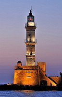 The lighthouse at the old port of Chania during dusk time, Crete island, Greece