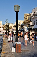 People walking at the old port of Chania, Crete island, Greece