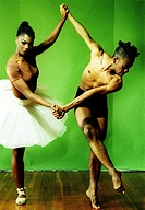 Male and female ballet dancers holding hands of each other and dancing (thumbnail)
